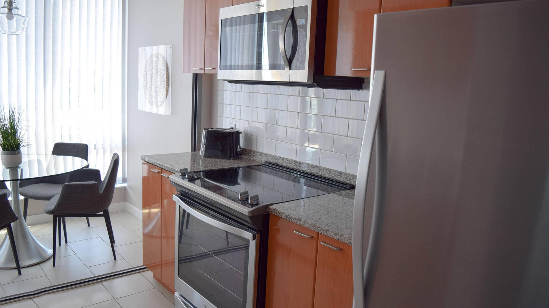 Kitchen And Dining Room In Two Bedroom Furnished Apartment