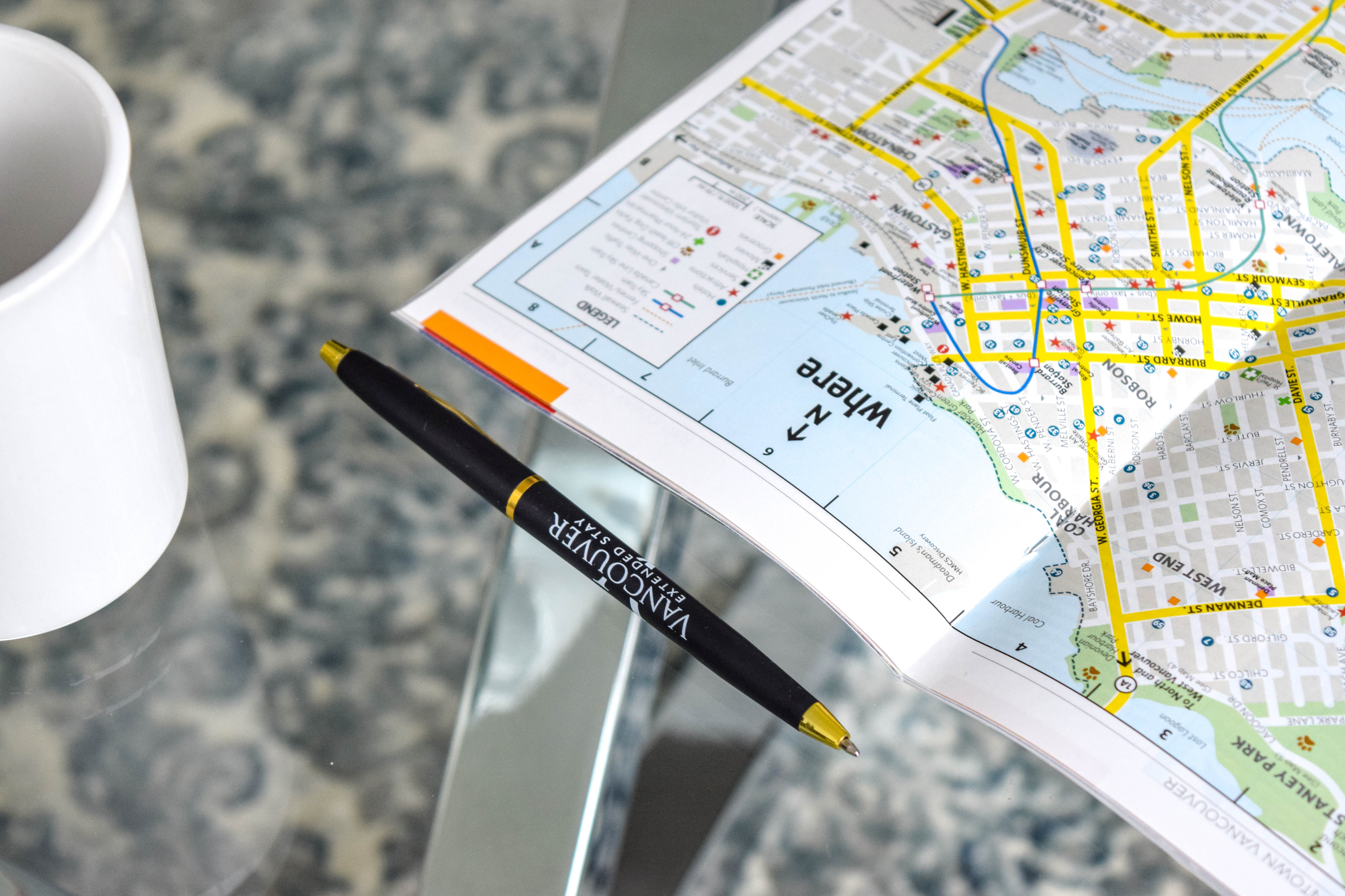 Vancouver's map on the table with pen and mug