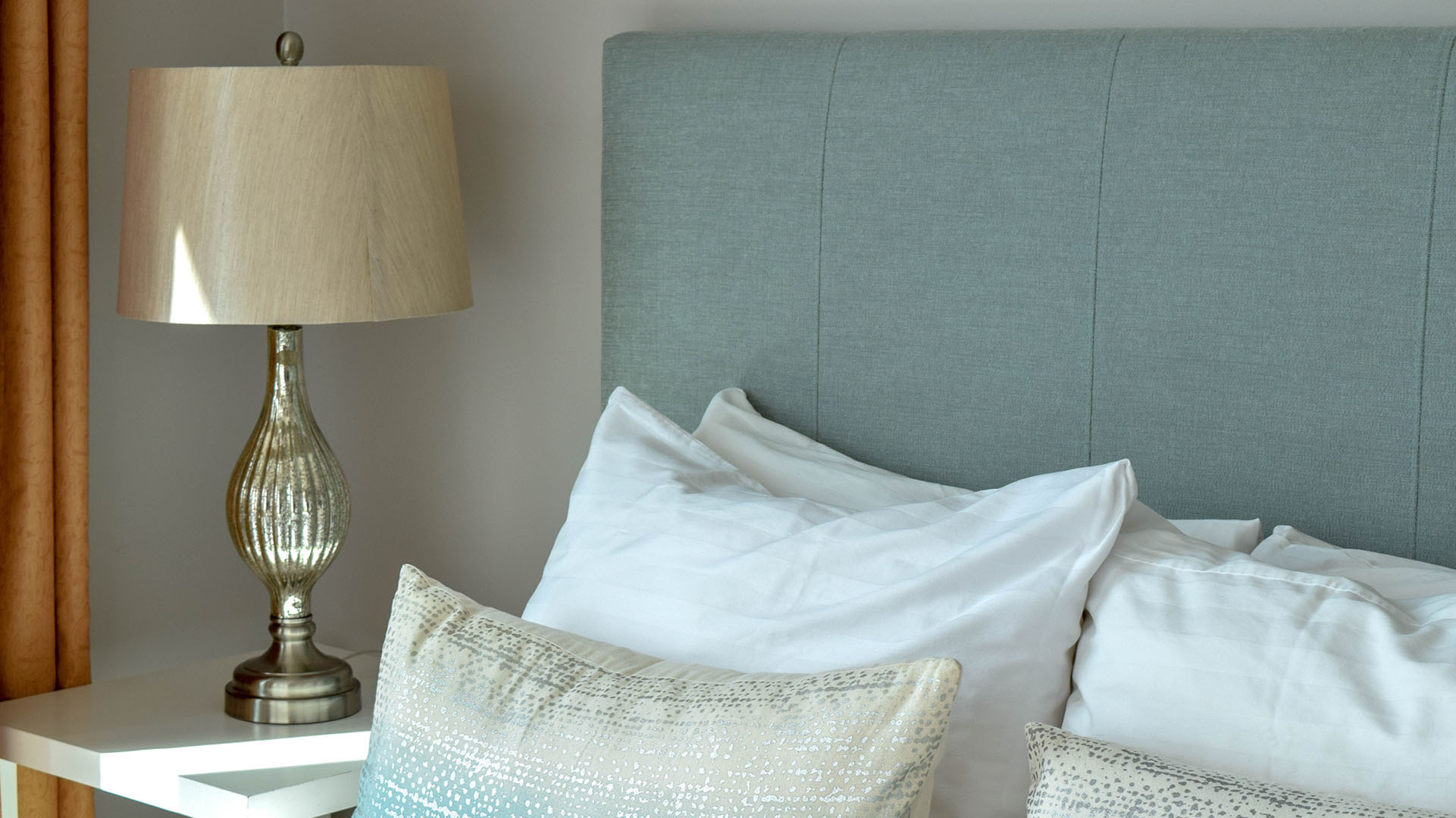 white and fresh linens and nice decor at Vancouver Extended Stay