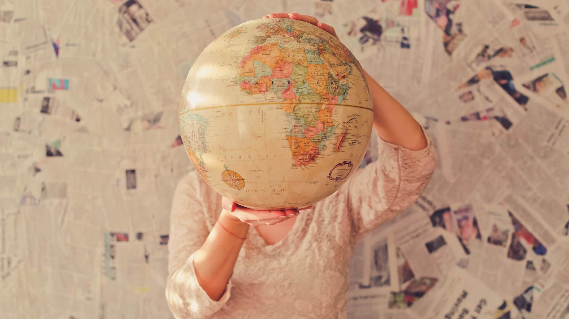 woman holding a world globe