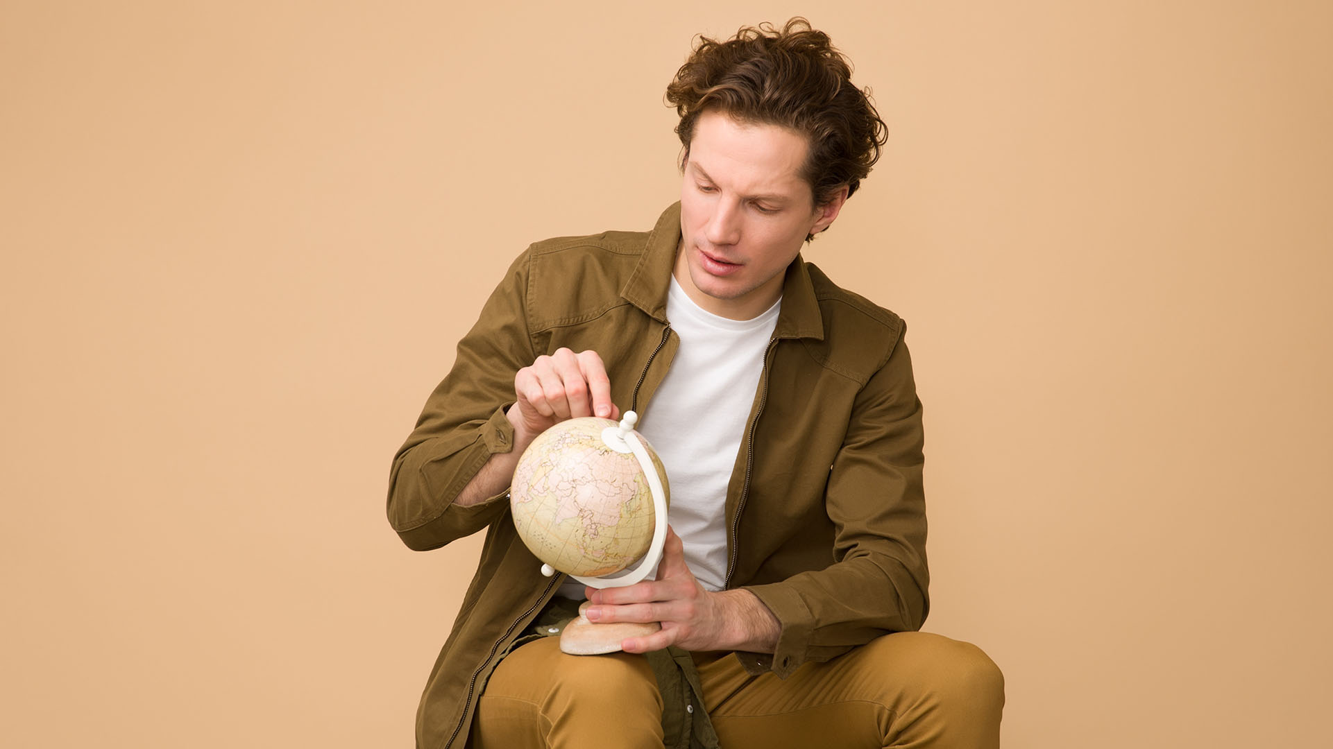man holding a world globe