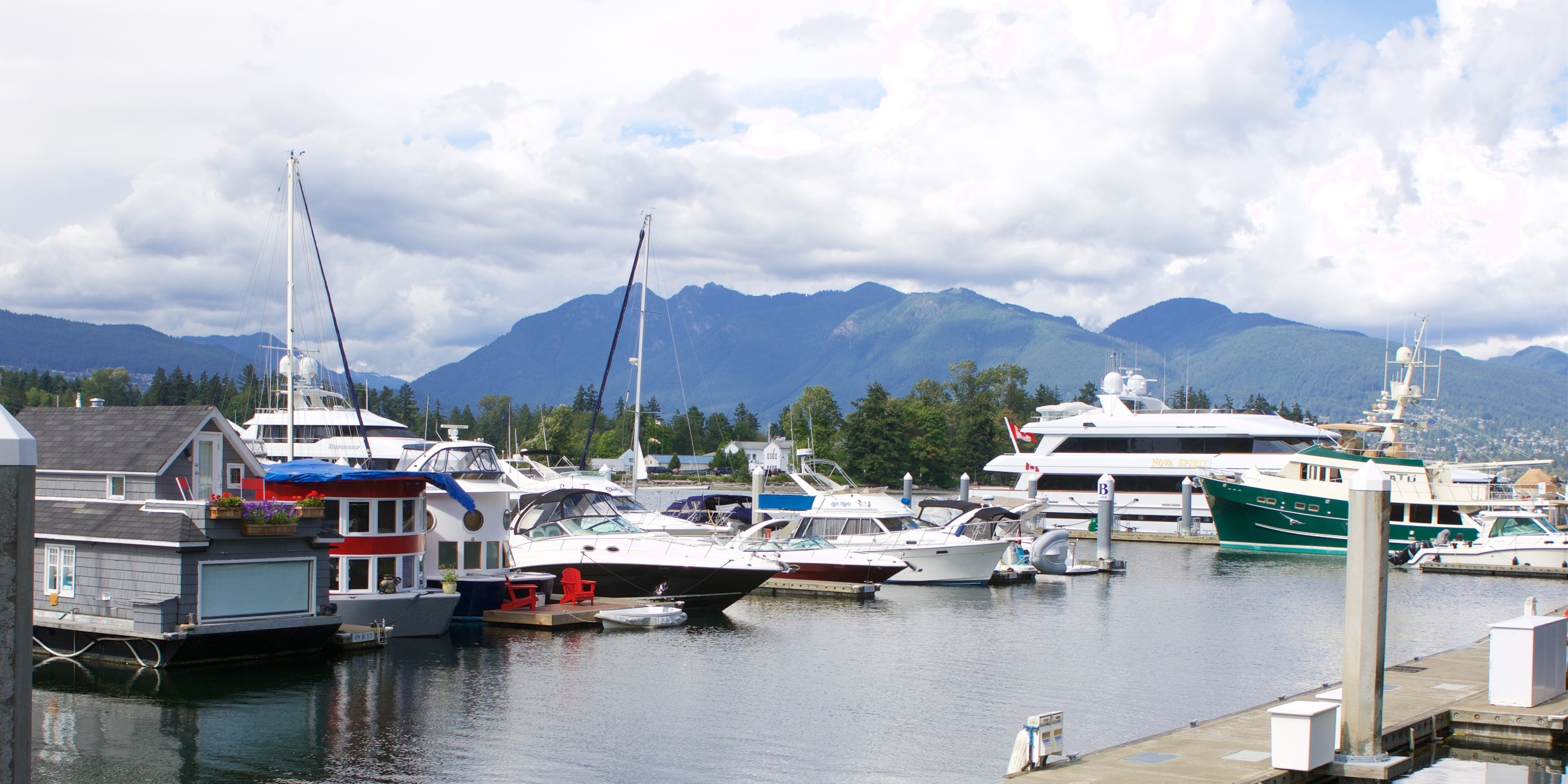 coal harbour with boats mountain and water